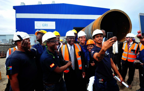 President Ramaphosa, with dti Minister Rob Davies, on a guided tour of the GRI Towers factory that forms part of the Special Economic Zone in Atlantis.