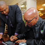 Home Affairs Deputy Director-General of Information Services, Sello Mmakau and President Jacob Zuma as he applies for a smart ID at Mahlamba Ndlopfu. Source: GCIS
