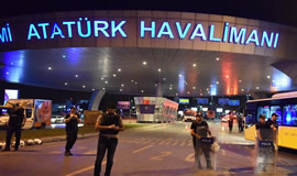 Policemen stand guard at the entrance to Ataturk International Airport in Istanbul, Turkey, after the bomb attacks that killed 36 people on Tuesday night. Xinhua
