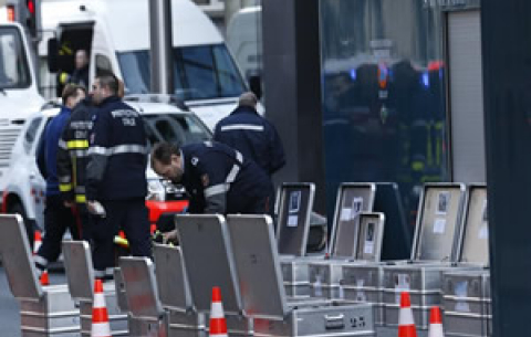Investigators and security personnel work outside the Maalbeek metro station in Brussels, capital of Belgium, on 22 March 2016. Source: Xinhua/Ye Pingfan